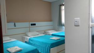 Cama ou camas em um quarto em Lider Hotel