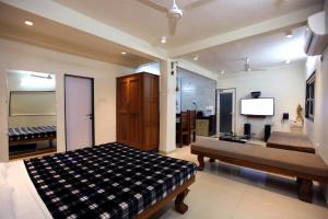A bed or beds in a room at Yash Villa