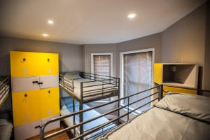 A bunk bed or bunk beds in a room at Prime Backpackers Bournemouth