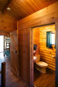 A bathroom at Fremont Jellystone Park Cottage 31