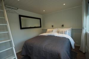 Ein Zimmer in der Unterkunft Krøgeneslåven Microtel