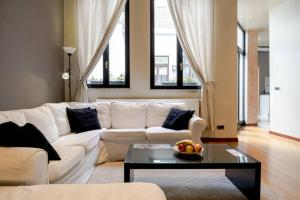 A seating area at Appartement Grand Place