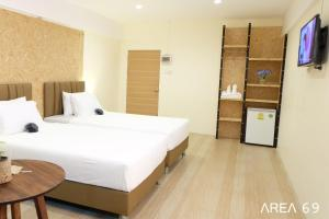 A bed or beds in a room at Area 69 (Don Muang Airport)