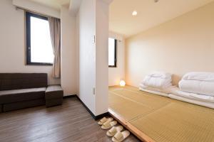 A seating area at Onna Japanese Style Hotel Hokkaisou