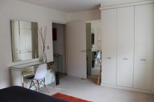A television and/or entertainment center at Chelmsford Serviced Apartments