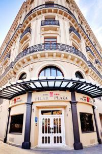 The facade or entrance of Hotel Pilar Plaza