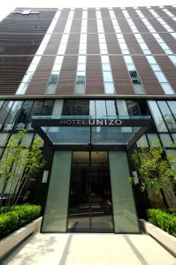 The facade or entrance of HOTEL UNIZO Tokyo Shibuya
