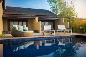 The swimming pool at or near Meghauli Serai Chitwan National Park - A Taj Safari Lodge