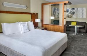 A bed or beds in a room at SpringHill Suites Long Island Brookhaven