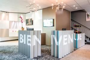 The lobby or reception area at ibis Styles Antony Paris Sud
