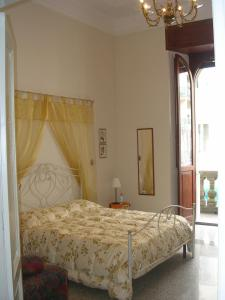 A bed or beds in a room at Ascoli Antica B&B