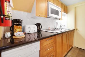 A kitchen or kitchenette at Whistler Village Centre by Elevate Vacations