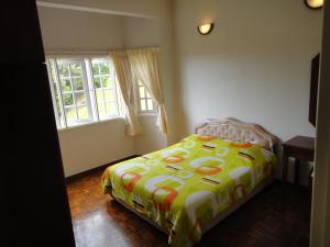 A bed or beds in a room at New Holiday Apartment - Greenhill Resort