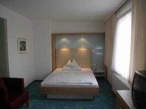 Postel nebo postele na pokoji v ubytování Dom Hotel