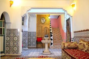 Salon ou bar de l'établissement Maison d'hôtes Cité Portugaise