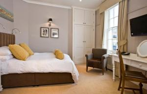 A bed or beds in a room at The Royal Albion