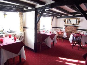 A restaurant or other place to eat at Old Lamb Hotel