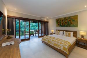 Een kamer bij Alamdini Resort Ubud