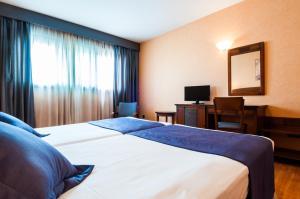 Кровать или кровати в номере Hotel Las Provincias