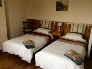 A bed or beds in a room at Maison Lajus