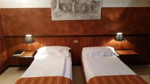Letto o letti in una camera di Ai Cadelach Hotel Giulia