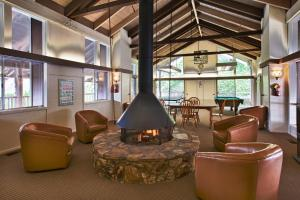 The lounge or bar area at Lake Arrowhead Chalets, a VRI resort
