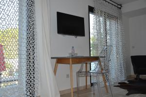 A television and/or entertainment center at Villa Le Sud