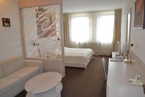 A room at Hotel Slamený dom