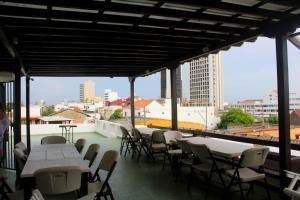 El salón o zona de bar de Hotel Villa Colonial By Akel Hotels