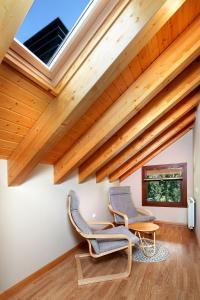 Zona de estar de PirineosNature Apartments