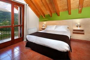 Cama o camas de una habitación en PirineosNature Apartments