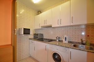 Una cocina o zona de cocina en Apartamento en Salou