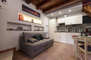 Area soggiorno di Ortigia Deluxe S.A.L.