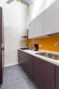 A kitchen or kitchenette at BBCHARME La Casa Sui Tetti