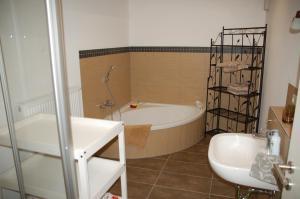 Ein Badezimmer in der Unterkunft Carles Scheunenhof