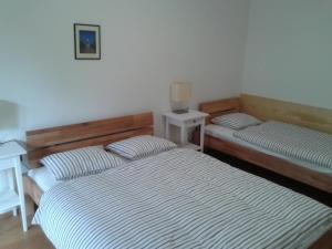 Ein Bett oder Betten in einem Zimmer der Unterkunft Kovárna Residence apartments