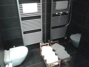 Ein Badezimmer in der Unterkunft Kovárna Residence apartments