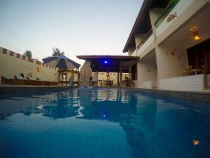 The swimming pool at or near Pousada Lua Vermelha