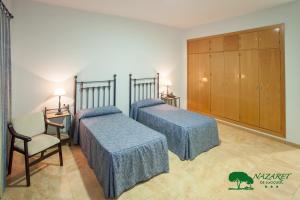 Cama o camas de una habitación en Complejo Turístico Rural Nazaret De Moguer