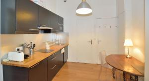 A kitchen or kitchenette at Appart' Pradel