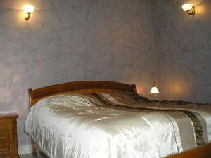 Кровать или кровати в номере АпартОтель Ривьера-Саратов