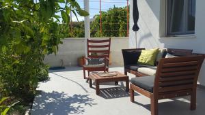 A seating area at Apartment Kairos
