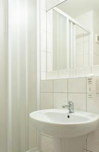 A bathroom at Hotel Harmonie