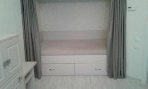 A bunk bed or bunk beds in a room at Apartments at Mayskiy proezd