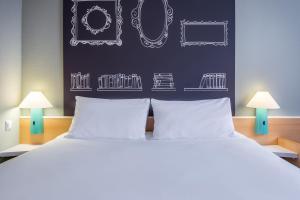 Кровать или кровати в номере Ibis Szczecin Centrum