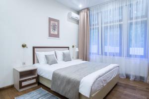 Кровать или кровати в номере Палисад Resort