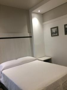 Um quarto em Scarpelli Palace Hotel