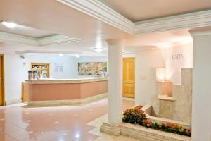 The lobby or reception area at Caitá Hotéis