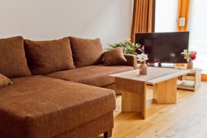 Ein Sitzbereich in der Unterkunft Ferienwohnung Im Bürgermeisterhaus
