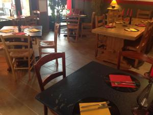 A restaurant or other place to eat at La Commune